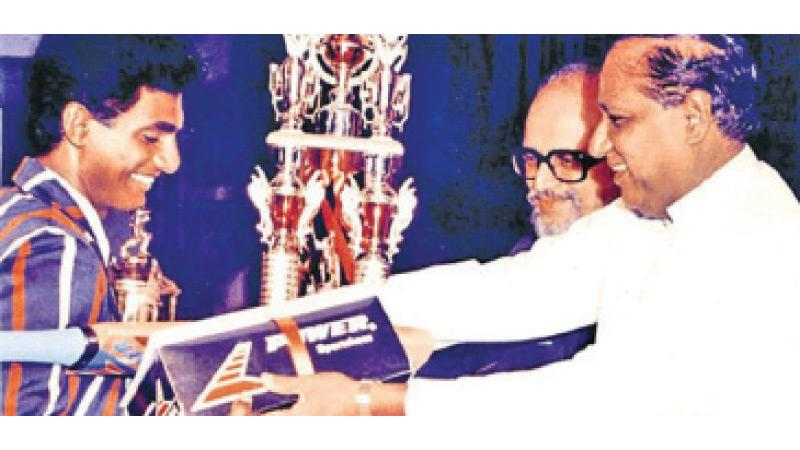 Flashback: Muttiaih Muralidaran of St. Anthony's College, Katugastota receiving the glittering Observer Schoolboy Cricketer Trophy 1991 title from the chief guest, the late Minister of Housing Sirisena Cooray while the then Chief Editor of the Sunday Observer Mahindapala looks on