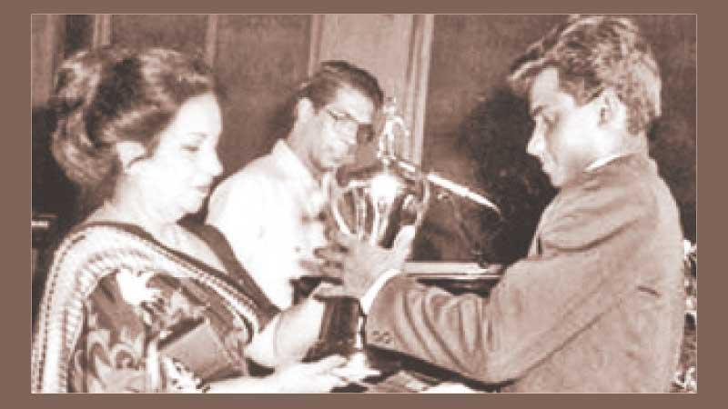 Flashback: Before conquering the Mount Everest of international cricket, young Sanath Jayasuriya received the Observer Schoolboy Cricketer of the Year Outstation award in 1988. He receives the trophy from Mrs. Malini Bodinagoda, wife of then ANCL Chairman Ranapala Bodinagoda, while compere Laddie Hettiarachchi looks on
