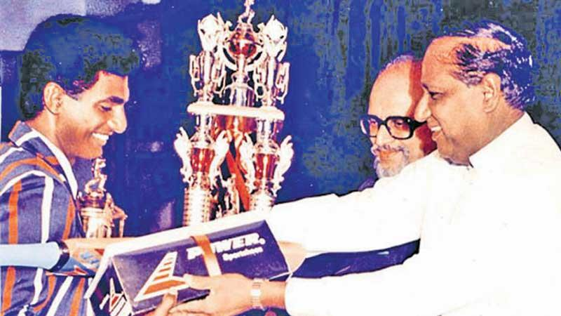 Flashback 30 years ago: Muttiah Muralidaran of St. Anthony's College, Katugastota receiving the Observer Schoolboy Cricketer of the Year 1991 title from then Housing and Construction Minister, the late B. Sirisena Cooray watched by then Editor-in-Chief of Sunday Observer H.L.D. Mahindapala