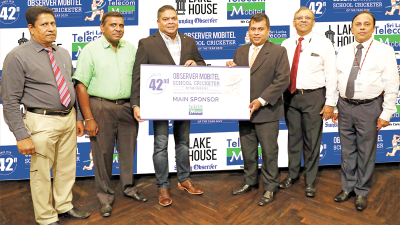 Director Legal ANCL Rakitha Abeygunewardena (fourth from left) receiving the sponsorship for the 42nd Observer Mobitel School Cricketer from Chief Executive Officer Sri Lanka Telecom Mobitel Nalin Perera. Also in the picture is Editor in Chief of the Sunday Observer Dinesh Weerawansa (second from left), General Manager ANCL Abaya Amaradasa (second from right), Chanaka Liyanage (left-Manager Publicity) and Waruna Mallawaarachchi (right-DGM Advertising)