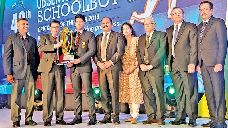 Flashback: Last year's winner Hasitha Boyagoda of Trinity College receiving the Observer-Mobitel Schoolboy Cricketer of the Year trophy from chief guest and winner of the inaugural event 40 years ago, Ranjan Madugalle, in the presence of SLSCA and Lake House officials including Sunday Observer editor Dharisha Bastians