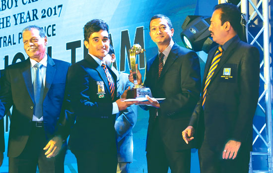 Trinity College captain Shanogeeth Shanmuganathan receives the trophy for the Best Team Central Province