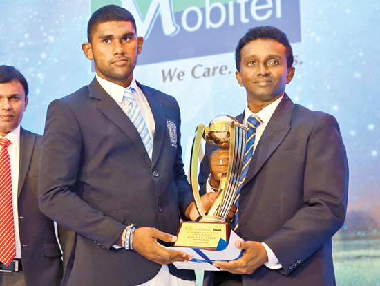 Jehan Daniel the Best All-rounder from St. Joseph's College receiving his award from Rohitha Kottachchi the Secretary Sri Lanka Umpires and Scorers Association
