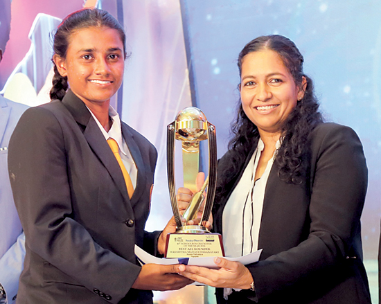 Best All-round Schoolgirl cricketer Harshitha Madavi form Anula Vidyalaya Nugegoda receives her award from Madara de Mel the Deputy General Manager Brand and Activation, Lake House
