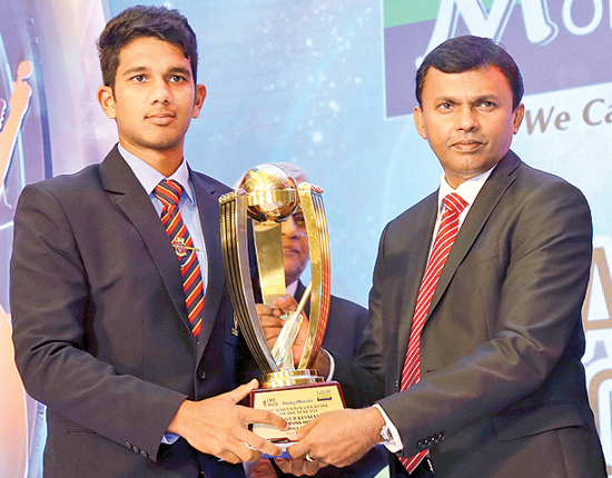 The best Batsman of the year Hasitha Boyagoda, Trinity College being Awarded the Trophy by Director Finance Lake House  Dushyantha Basnayake