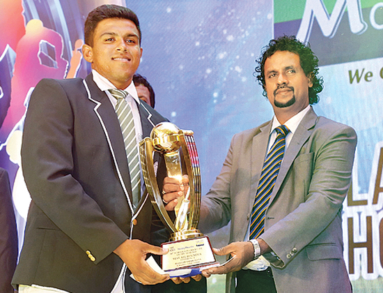Maheesh Theekshan, St. Benedict's College receives his the Best Allrounder Award receiving the Award from Dilshan de Silva Secretary Sri Lanka Schools Cricket Association