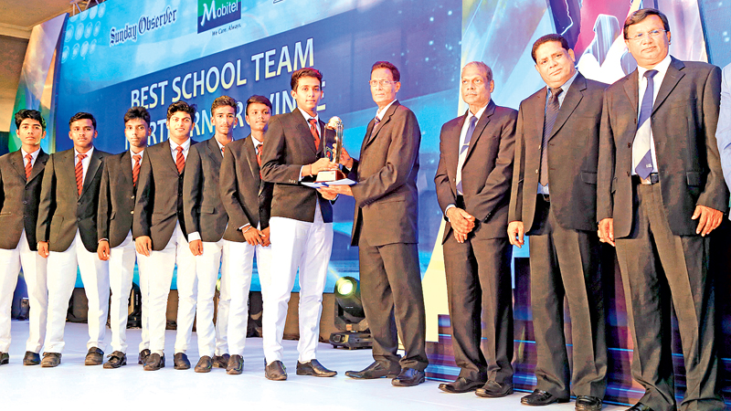 Skipper of St. John's College Jaffna receiving the Best Team Award for the Nothern Province from Saadi Thawfeeq Group Sports Editor for English Papers- ANCL