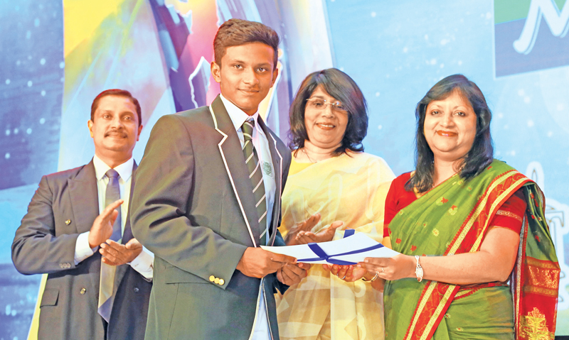 Sanjula Abeywickrama of Isipathana College the runner-up of the Most Popular Schoolboy Cricketer voting contest being presented with his Certificate by Secretary ANCL Kumudu Gunawardene