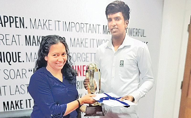 The Best All-rounder in the Div. III category Mithila Poornajith accepts his Award from Madara de Mel the Deputy General Manager Branding and Communications of Lake House.