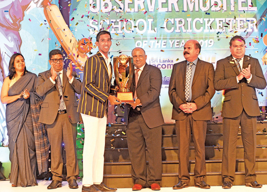Observer Mobitel School Cricketer of the Year 2019 Chief Guest Aravinda de Silva handing over the Schoolboy Cricketer of the Year Award to Kamil Mishara of Royal College. Also pictured on stage are Krishantha Cooray (Chairman Lake House), Nalin Perera (CEO Mobitel) and Kumarasinghe Sirisena (Group Chairman SLT). (Pic: Ishara S. Kodikara)