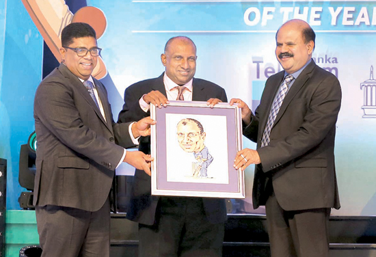 Krishantha Cooray (L) Chairman of ANCL and P.G. Kumarasinghe (Chairman Telecom and Mobitel (Pvt) Limited) presenting a portrait to Aravinda de Silva done by Sunday Observer cartoonist Wasantha Siriwardena