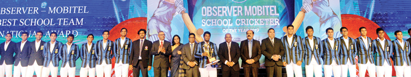 Cricketers from S. Thomas' College Mount Lavinia pose with their prize as the Best team at the Sunday Observer-Mobitel Schoolboy Cricketer Awards held at the Hilton Hotel in Colombo on Friday night in the company of Chief Guest Aravinda de Silva, P.G. Kumarasinghe (Chairman SLT, Mobitel), Krishantha Cooray (Chairman ANCL) and Nalin Perera (CEO Mobitel)
