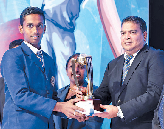 Winner of Division III Most Popular Cricketer of the Year 2019 YAD Sandaruwan of Galahitiyawa Central receiving the coveted Award