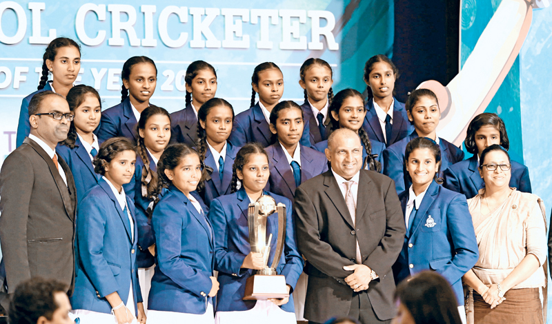 Emerging School Girls team Holy Cross College Gampaha with chief guest Aravinda de Silva