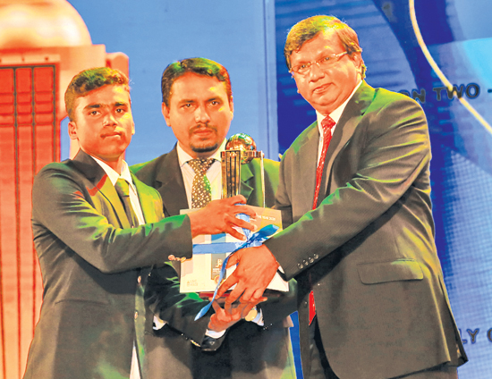 Best  Wicket Keeper Division Two Bashitha Perera of Holy Cross College, Kalutara is presented with his award by Deputy General Manager, Establishment ANCL Narada Sumanaratne with DGM Sales Nath Adikri