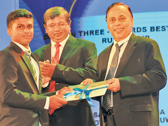 Division Three Best batsman Prabuddha Premalal of Ibbagamuwa Central College gets his award from Deputy General Manager Advertising ANCL, Waruna Mallawaarachchi