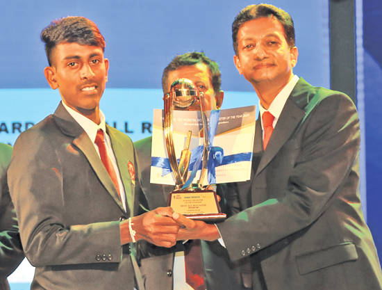 Division Two Best All-rounder Samith  Isuru of Karandeniya Central College is presented with his award from Acting General Manager of ANCL Sumith Kotalawela