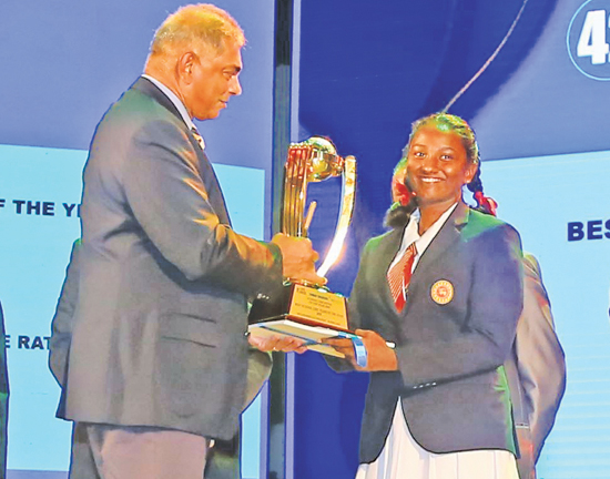 Captain of the Best Schoolgirl Team of the Year 2020 receives the award from Chairman of SLT Mobitel Rohan Fernando