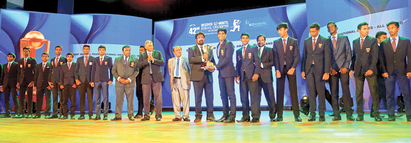 Best schoolboy team 2020 (all island) Trinity College Kandy receive their trophy presented by guest of honour, Minister of Information and Media Keheliya Rambukwella in the presence of ANCL Chairman W. Dayaratne PC (Pix: Sudath Malaweera)
