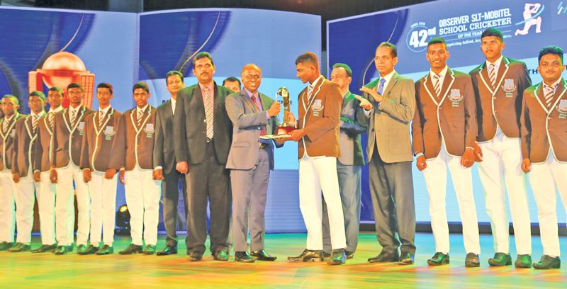 Captain of the Best School Team of the Southern Province St. Thomas College, Matara is presented with their award given by ANCL Director Operations, Canishka Witharana
