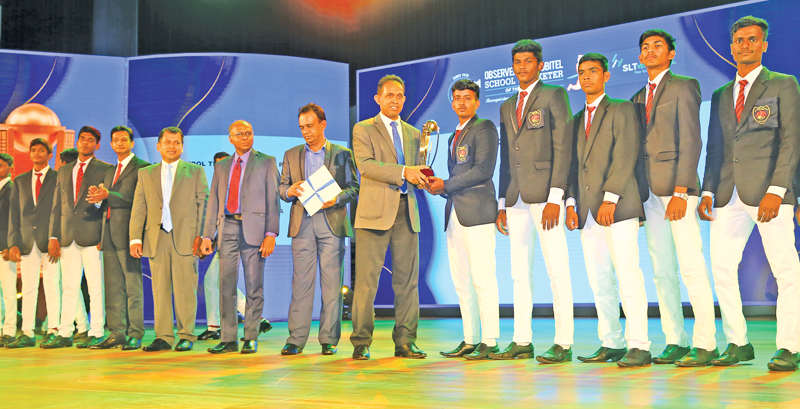 Captain of the Best School Team of the Northern Province St. John's College Jaffna is presented with their award given by ANCL Director Finance, Janaka Ranatunga
