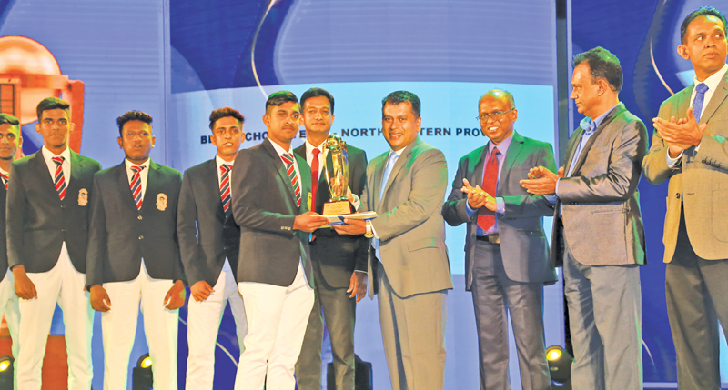 Captain of the Best School Team of the North Western Province St. Sebastian's College, Katuneriya is presented with their award given by ANCL Director Legal and Administration, Rakhitha Abeygunawardhana