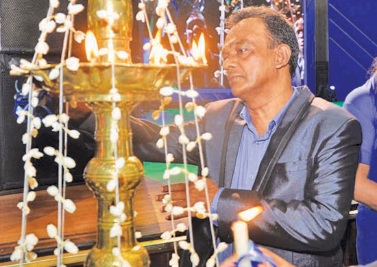 Lighting of the traditional oil lamp by  Director Editorial Dharma Sri Kariyawasam