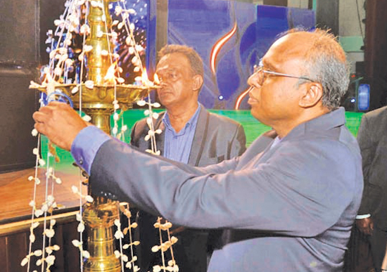 Lighting of the traditional oil lamp by  Director Operations, Canishka Witharana