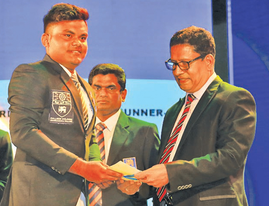 Division one - Best Bowler - Runner- up Lohan Aroshana de Zoysa of Dharmasoka College, Ambalangoda recieves award from Chanaka Liyanage Manager Channel Publicity of ANCL