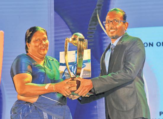 Best Batsman - Division one - winner Pawan  Ratnayake - Mahanama College Colombo. His mother receives the Award on behalf of him from official statistician Batsman.com CEO Kumara Gamhewage