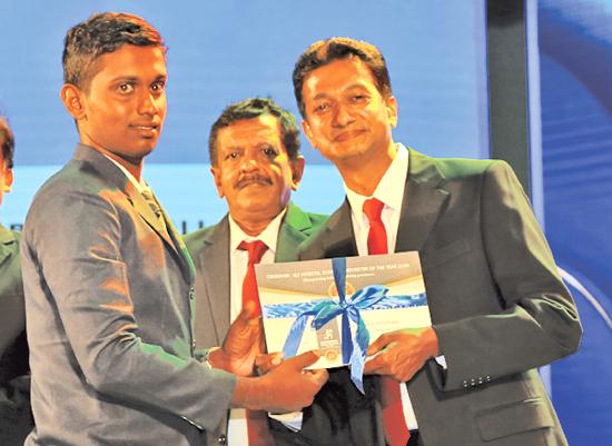 Awards Best All Rounder - Division Two - Runner up Sandaruwan Chinthaka of Galahitiyawa Central College receives the Award from Acting General Manager of ANCL, Sumith Kothalawela
