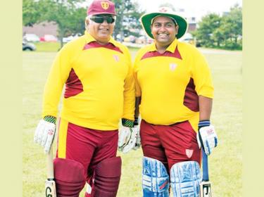 Flashback: Arjuna Ranatunga and his son Dhyan prepare to bat for Ananda in a old boys match against Nalanda in Canada